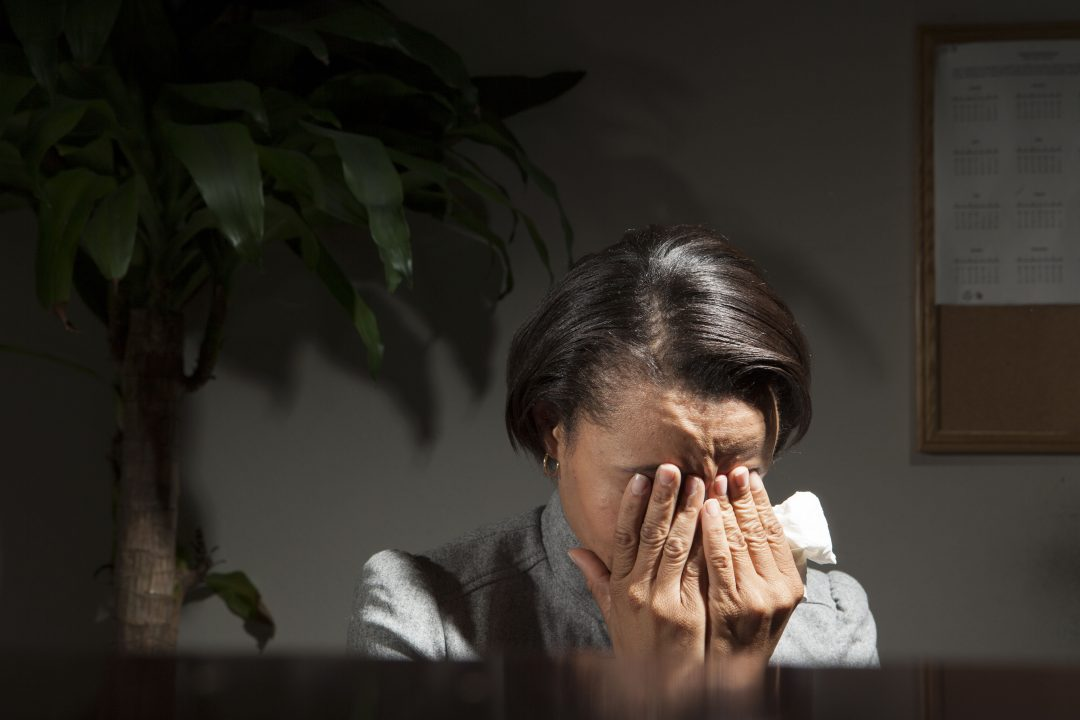 Business woman with headache from TMJ pain